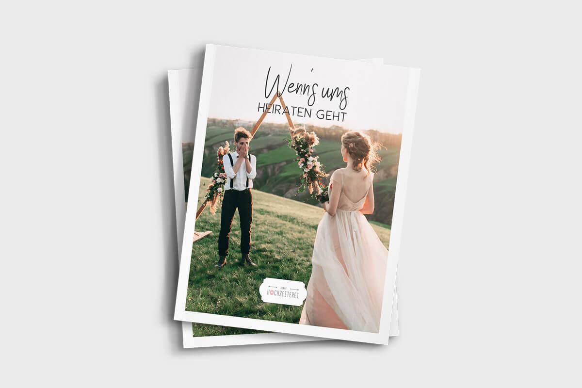 Deckblatt Hochzeitsmagazin, glückliches Hochzeitspaar auf Wiese